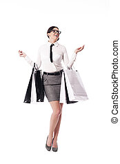 Happy businesswoman holding full of shopping bags