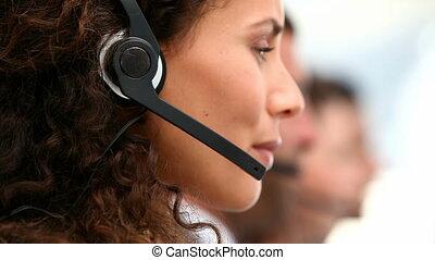 Happy businesswoman in call centre