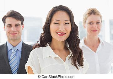 Happy businesswoman in front of her team