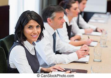 Happy businesswoman in meeting