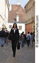 Happy businesswoman in the city