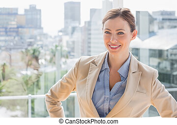 Happy businesswoman looking at camera