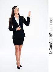 Happy businesswoman looking up