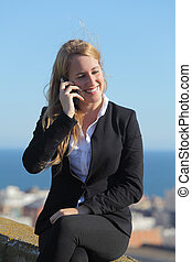 Happy businesswoman on the mobile phone