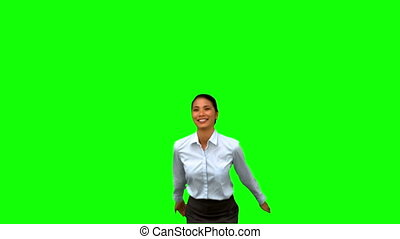 Happy businesswoman raising arms on green screen in slow...
