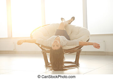 happy businesswoman relaxing in a comfortable chair