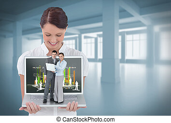 Happy businesswoman showing laptop