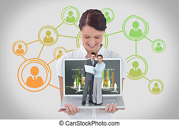 Happy businesswoman showing laptop with business people on it