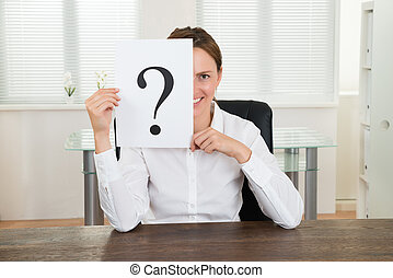 Businesswoman Showing Question Mark On Paper