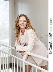 Happy businesswoman standing in hallway