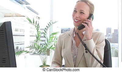 Happy businesswoman talking on a phone