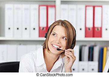 Happy businesswoman talking on headset