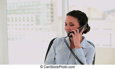 Happy businesswoman talking