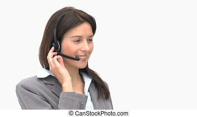 Happy businesswoman talking on a headset isolated on a white...