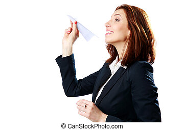 Happy businesswoman throwing paper plane isolated on a white...