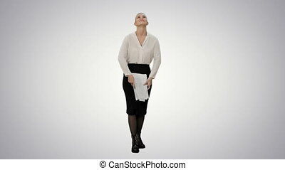 Happy businesswoman throws paper document pages and smiling...