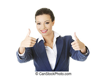 Happy businesswoman thumbs up