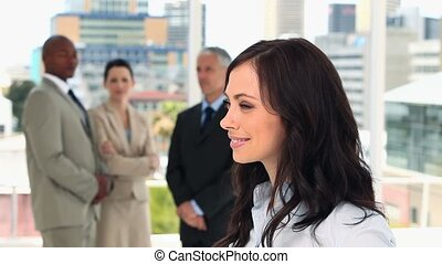 Happy businesswoman turning her head