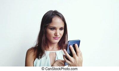 Happy businesswoman uses mobile phone press by media or...