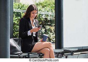 Happy Businesswoman Using Cellphone
