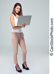 Happy businesswoman using laptop