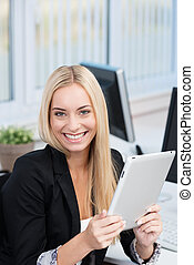 Happy businesswoman with a tablet-pc