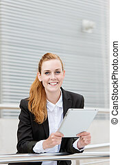 Happy Businesswoman With Digital Tablet