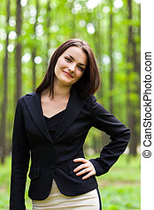Happy businesswoman with hand on her hip