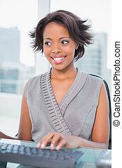 Happy businesswoman working on her computer