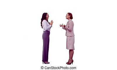 Happy businesswomen in slow motion laughing