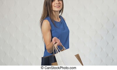 Happy Buyer with Shopping Bags - Tilt up of a happy buyer...