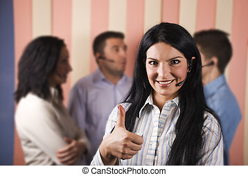Happy call center woman giving thumbs up - Happy customer...