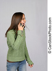 Happy Caller - cute brunette girl on cell phone laughing