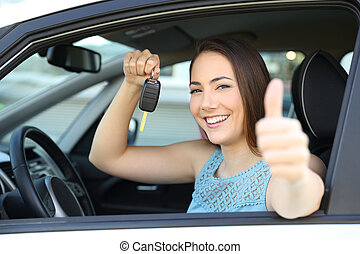 Happy car owner with a key and thumbs up