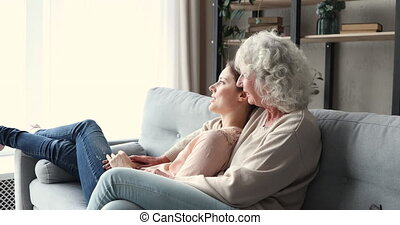 Happy carefree two generations women family relaxing in living room