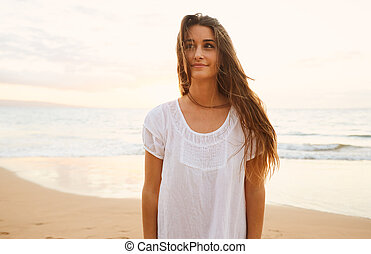 Happy Carefree Woman on the Beach at Sunset