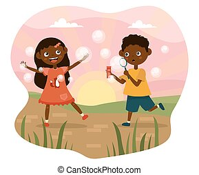 Happy carefree young children playing with bubbles