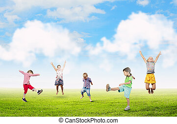 Happy careless childhood - Group of children jumping high in...