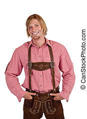 Happy casual Bavarian man with oktoberfest leather trousers (lederhose)