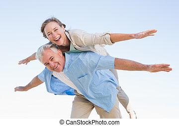 Happy casual couple having fun