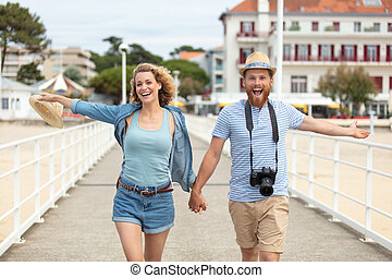 happy casual couple on the pier