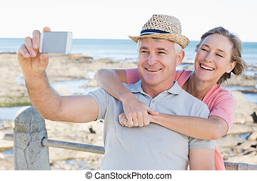 Happy casual couple taking a selfie