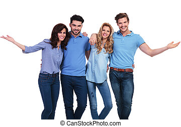 happy casual group of casual people welcoming you
