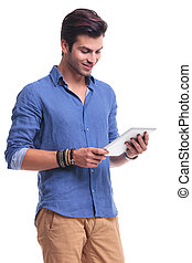 happy casual man reading on a tablet