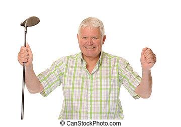 Happy casual mature golfer celebrating