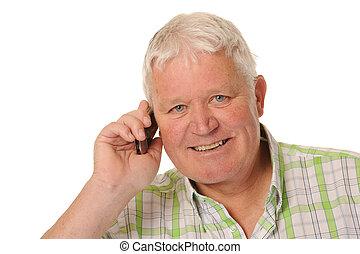 Happy casual mature man using mobile phone