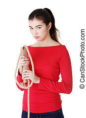 Happy casual woman holding a rope.