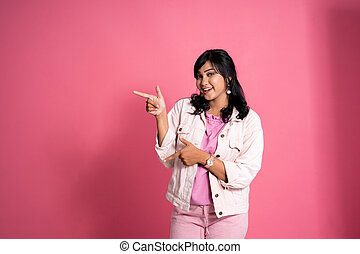 casual woman pointing to copyspace on the side