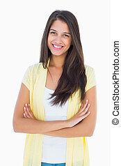 Happy casual woman smiling at camera on white background