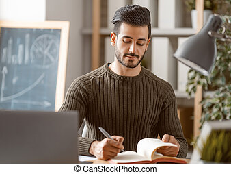 man working on a laptop at home.